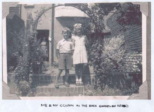 Peter Young and cousin in 30 Grange Road back garden, Lewes