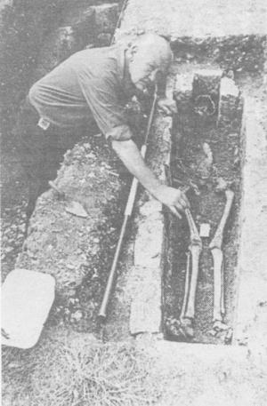 Richard Lewis excavating a skeleton, Lewes