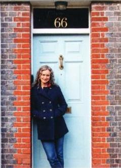 Carlotta Luke against door