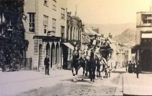 Coach and four ascending School Hill, Lewes, postcard