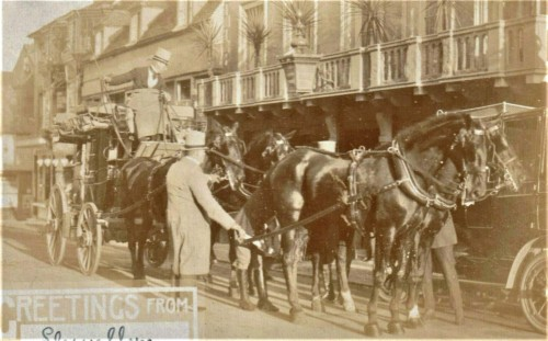 Coach and four outside White Hart, Lewes, postcard posted 1913
