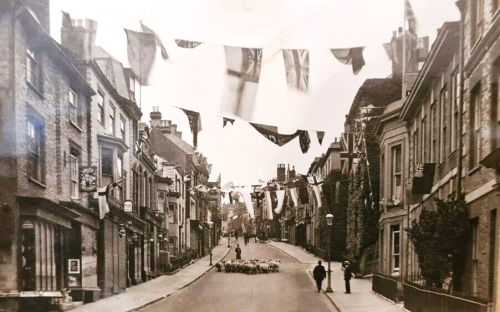 Sheep and flags on School Hill, lewes, postcard