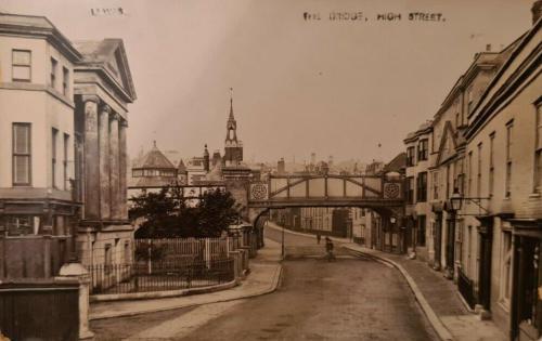 Railway bridge across Lewes High Street, postcard