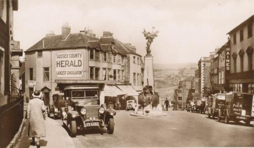 Traffic on Lewes High Street near War Memorial, postcard